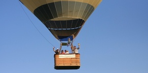 contact us Above Reality Hot Air Balloons - men in hot air balloon basket waving on Vermont tour